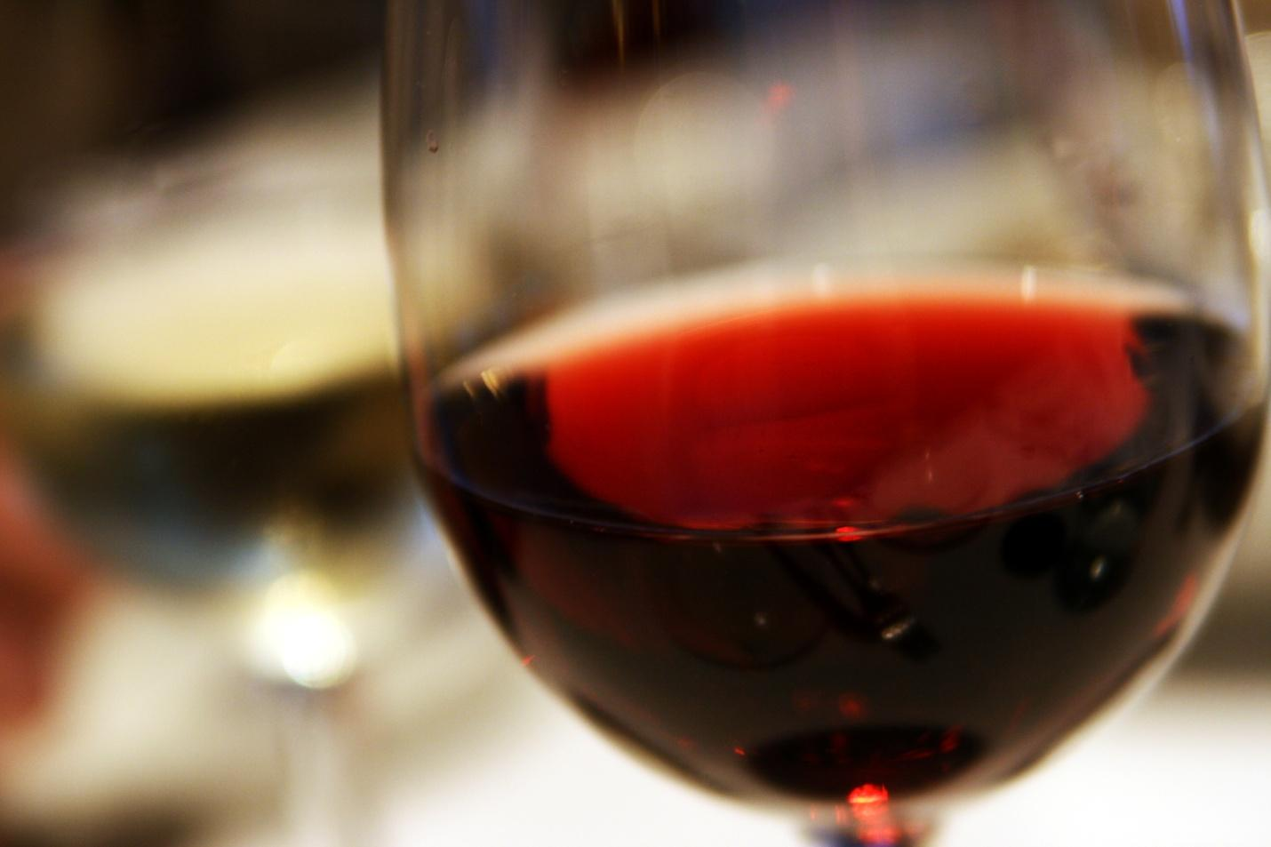 a picture of a glass of deep red wine