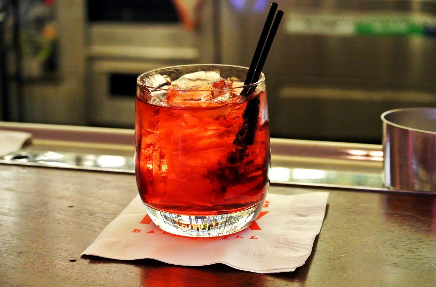 A finger-stirred Negroni is what you need in the summer heat